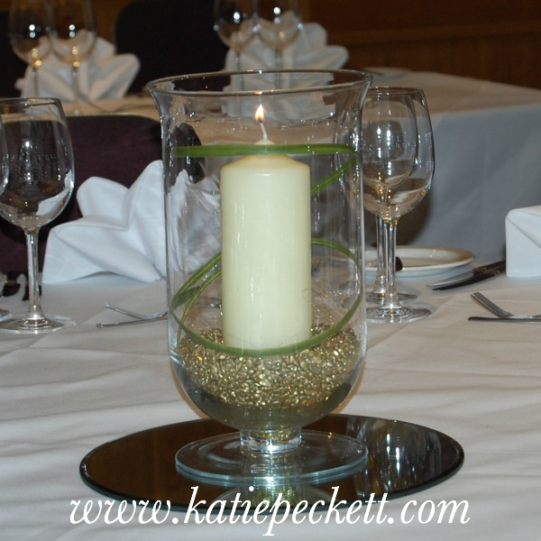 Glass hurricane vase wedding table centerpiece with church