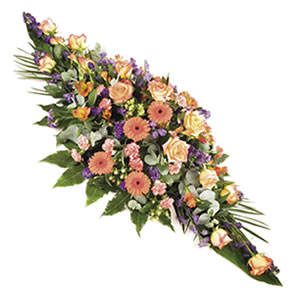 warm and vibrant casket spray Sheffield funeral flowers